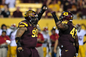 Sep 28, 2013; Tempe, AZ, USA; Arizona State Sun Devils defensive tackle Will Sutton (90) celebrates with defensive end Davon Coleman (43) after sacking USC Trojans quarterback Cody Kessler (6) during the first half at Sun Devil Stadium. Mandatory Credit: Matt Kartozian-USA TODAY Sports