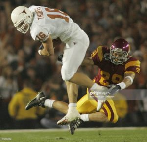Texas' David Thomas (16) eludes USC's Scott Ware (29) as No. 2 Texas beat No. 1 USC 41-38, Wednesday, January 4, 2006 in the Rose Bowl in Pasadena, California. (Ron Jenkins/Fort Worth Star-Telegram/KRT)